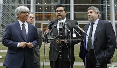 Luis Cortes, center, an attorney for Daniel Ramirez Medina, talks to reporters in Seattle, as fellow attorneys, from left, Theodore Boutrous Jr., Ethan Dettmer and Mark Rosenbaum, listen, March 8, 2017. Medina, a Seattle-area man, was arrested in Feb...