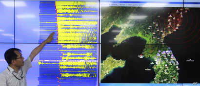 Earthquake and Volcano of the Korea Monitoring Division Director Ryoo Yong-gyu speaks in front of a screen showing seismic waves that were measured in South Korea, in Seoul, South Korea, Sept. 9, 2016.