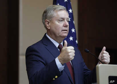 Republican Sen. Lindsey Graham gestures as he speaks to reporters in Ankara, Turkey, Saturday, Jan. 19, 2019, a day after meeting with Turkish President Recep Tayyip Erdogan and other officials. Graham says a U.S. withdrawal from Syria without a plan...