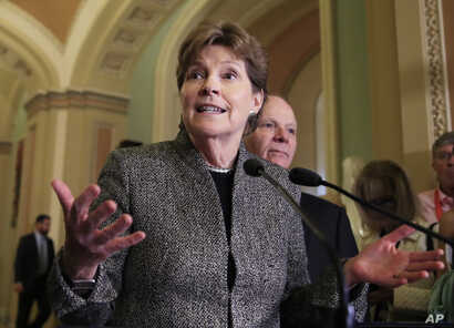 FILE - Sen. Jeanne Shaheen speaks to reporters on Capitol Hill in Washington, Oct. 24, 2017.