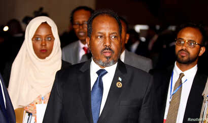 Somali's former president Hassan Sheikh Mohamud is escorted as he leaves a meeting in Ethiopia's capital Addis Ababa, Jan. 30, 2017.