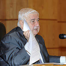 Syria's Foreign Minister Walid al-Moualem shows documents during a news conference in Damascus, November 14, 2011, in this handout photograph released by Syria's national news agency SANA.