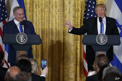 President Donald Trump speaks during a news conference with Israeli Prime Minister Benjamin Netanyahu in the East Room of the White House in Washington, Feb. 15, 2017.