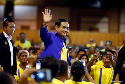 """Thailand's Prime Minister Prayut Chan-o-cha arrives  to deliver a keynote speech at the opening ceremony of """"National Fund to Reduce Inequalities"""" ahead of the general election, in Bangkok, Thailand, March 18, 2019."""