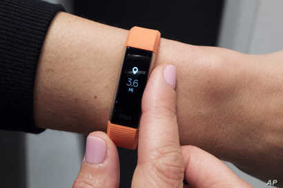In this March 1, 2017, file photo, Fitbit's new Alta HR device is displayed in New York. The Pentagon is doing a broad review of how military forces use exercise trackers and other wearable electronic devices.