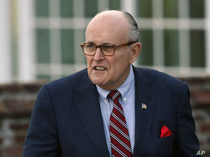 FILE - Former New York Mayor Rudy Giuliani arrives at the Trump National Golf Club Bedminster clubhouse in Bedminster, N.J., Nov. 20, 2016, President Donald Trump's new lawyer Rudy Giuliani said Wednesday the president repaid attorney Michael Cohen