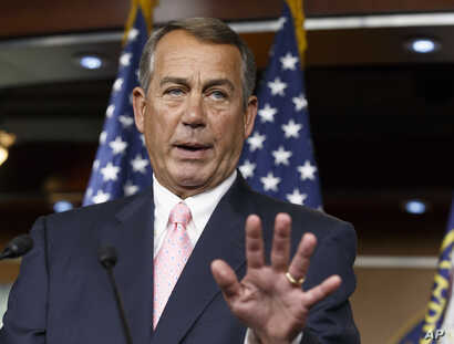 Speaker of the House John Boehner talks with reporters about the border crisis, veterans' health care, and future funding, on Capitol Hill, July 24, 2014.