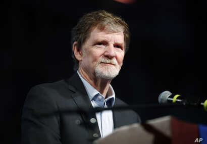 FILE - Jack Phillips, owner of Masterpiece Cake, speaks during a rally on the campus of a Christian college in Lakewood, Colo., Nov. 8, 2017. The small rally was held to build support for Phillips, who is at the center of a case considered by the U.S...