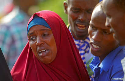 Relatives mourn family members killed in an attack by Somali forces and supported by U.S. troops, at Madina hospital in Mogadishu, Somalia, Aug. 25, 2017.