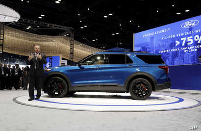 Joe Hinrichs, Ford's president of global operations of the Americas for Ford Motor Company, speaks during the media preview of the Chicago Auto Show at McCormick Place, Feb. 7, 2019, in Chicago.