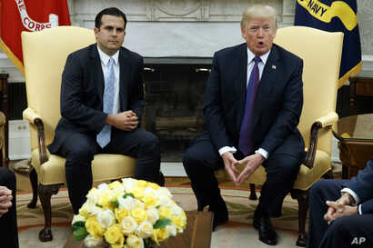 President Donald Trump speaks during a meeting with Governor Ricardo Rossello of Puerto Rico in the Oval Office of the White House, Oct. 19, 2017, in Washington.