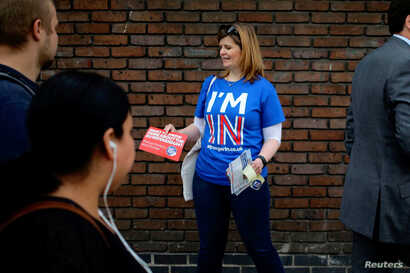 FILE - A woman campaigns in London, May 20, 2016, for Britain to stay in the European Union. The World Trade Organization's leader warns that a June 23 vote supporting Brexit could harm Britain's economy.