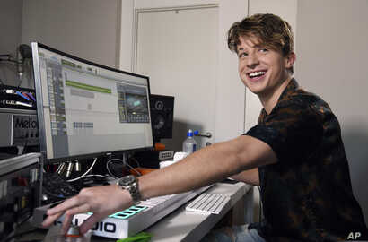 "Singer-songwriter Charlie Puth poses for a portrait in his home music studio in Beverly Hills, California, to promote his new album ""Voicenotes,"" May 29, 2018."