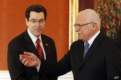 FILE - U.S. ambassador to the Czech Republic Norman L. Eisen, left, meets with Czech Republic's President Vaclav Klaus at the Prague Castle, Czech Republic, Jan. 28, 2011.