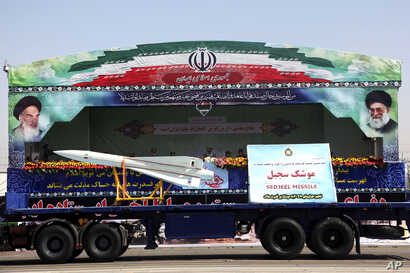 FILE - Sedjeel, an Iranian made ballistic missile, is showcased during an annual military parade in Tehran, Iran, Sept, 22, 2013.