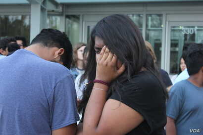 Alisha Marcial, daughter of Vicente Marcial Noyola, a single father of seven U.S. children who had been arrested for driving without a license, gets emotional during a vigil in front of the county jail in Raleigh where her father is detained. Marcial...