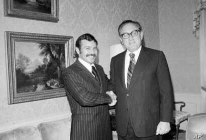 FILE - Abdelaziz Bouteflika, left, meets with U.S. Secretary of State Henry Kissinger at the U.S. State Department suite at the Waldorf Astoria Hotel Towers, Oct. 1, 1975.
