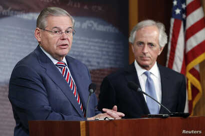 U.S. Senate Foreign Relations Committee Chairman Robert Menendez (L) and ranking member Senator Bob Corker are seen holding a news conference on Capitol Hill in Washington, D.C.