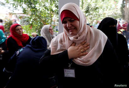 A Palestinian UNRWA employee reacts during a protest against jobs termination by UNRWA inside its headquarters in Gaza City, July 25, 2018.