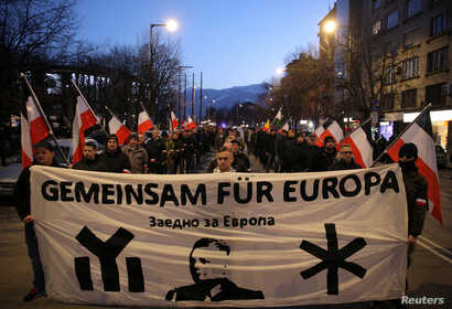 """Members and supporters of several nationalist organizations take part in a march in commemoration of the late Gen. Hristo Lukov, a Bulgarian army commander, in Sofia, Bulgaria, Feb. 16, 2019. The banner reads """"Together for Europe."""""""