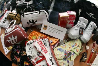 FILE - Counterfeit branded fashion goods are presented during the annual news conference of the customs duty office at Frankfurt Airport.