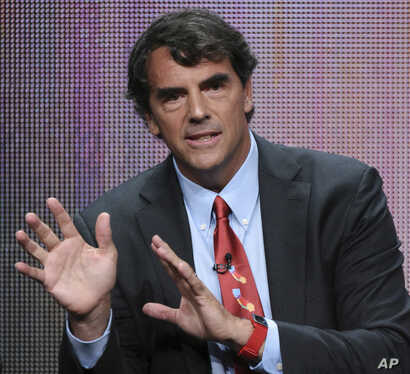 """FILE - Tim Draper, a prominent venture capitalist in Silicon Valley, participates in the """"Startup U"""" panel at the Disney/ABC Summer Television Critics Association Tour in Beverly Hills, Calif., Aug. 5, 2015."""