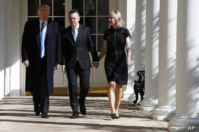 President Donald Trump walks with American Pastor Andrew Brunson and his wife, Norine Lyn, down the Colonnade of the White House before their meeting in the Oval Office, Oct. 13, 2018, in Washington.