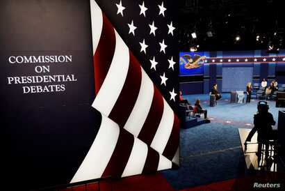 Students playing the roles of the candidates go through a rehearsal for the second 2016 U.S. presidential debate at Washington University in St. Louis, Missouri, Oct. 8, 2016.