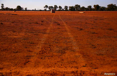 Tire tracks left by a truck can be seen in a drought-stricken paddock on Kahmoo Station property, located on the outskirts of the southwestern Queensland town of Cunnamulla in outback Australia, Aug. 10, 2017.