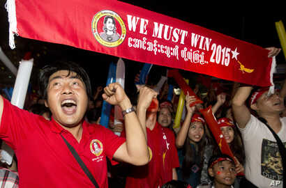 Supporters of Myanmar's National League for Democracy party cheer as election results are posted outside the NLD headquarters in Yangon, Myanmar, Nov. 9, 2015.