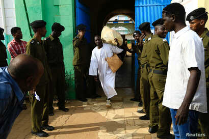 A prisoner leaves the national prison, after 259 prisoners from Darfur rebel movements were released according to the general amnesty decision of the President Omar al-Bashir, in Khartoum, Sudan, March 9, 2017