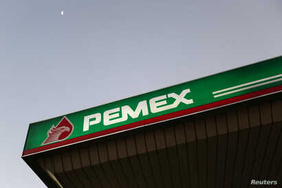 FILE - A Pemex gas station is seen in Mexico City. Pemex said the pipeline did not explode, but that the blast was from a nearby stolen fuel tank.