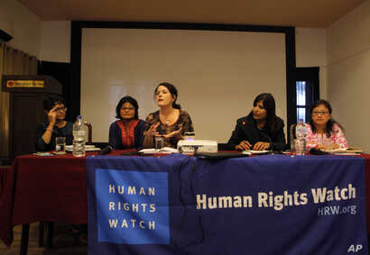 Heather Barr, center, a researcher at the New York-based Human Rights Watch, speaks during the release of a report on child marriage in Nepal in Kathmandu, Nepal, Sept. 8, 2016.