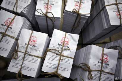 Copies of the newly adopted constitution lie bundled together for distribution to lawmakers at the constituent assembly hall in Kathmandu, Nepal, Sep 20, 2015.