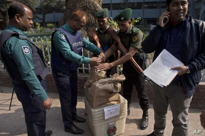 Bangladeshi police seal the voting material at a distribution center before being transported to polling stations on the eve of the general elections in Dhaka, Bangladesh, Dec. 29, 2018.