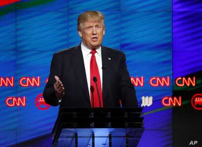 Republican presidential candidate, businessman Donald Trump,  speaks during the Republican presidential debate sponsored by CNN, Salem Media Group and the Washington Times at the University of Miami,  Thursday, March 10, 2016.