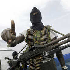 Militants wearing black masks, military fatigues and carrying Kalashnikov assault rifles and rocket-propelled grenade launchers patrol the creeks of the Niger Delta area of Nigeria, 24 Feb 2006