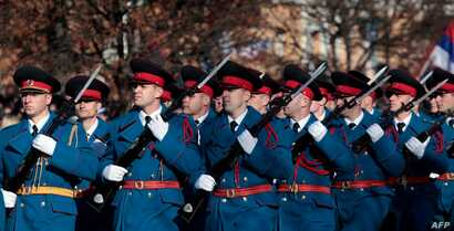 "Bosnian Serb police officers take part in a parade marking the ""Day of Republic Srpska,"" in Banja Luka, Jan. 9, 2019, defying a 2016 legal ban and angering Bosnian Muslims who viewed it as a provocation."