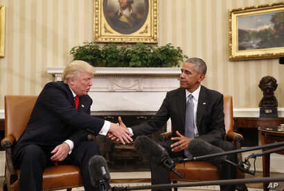 President Barack Obama shakes hands with President-elect Donald Trump in the Oval Office of the White House in Washington,  Nov. 10, 2016.