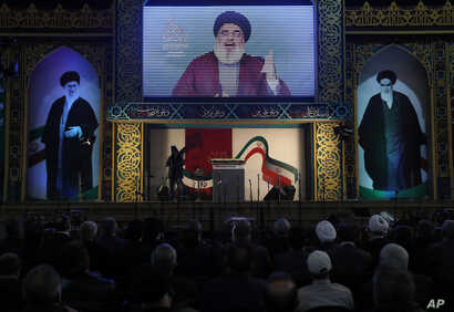 Hezbollah leader Hassan Nasrallah delivers a broadcast speech during a rally to commemorate the 40th anniversary of Iran's Islamic Revolution, in southern Beirut, Lebanon, Feb. 6, 2019.
