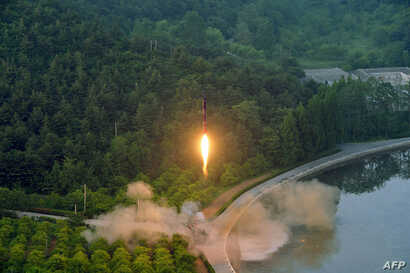This undated photo released by North Korea's official Korean Central News Agency (KCNA) on May 30, 2017 shows a test-fire of a ballistic missile at an undisclosed location in North Korea.