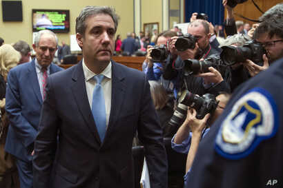 Michael Cohen, President Donald Trump's former lawyer, departs after testifying before the House Oversight and Reform Committee, on Capitol Hill, Feb. 27, 2019, in Washington.