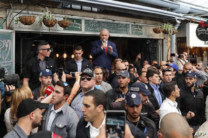 Israeli Prime Minister Benjamin Netanyahu, leader of the Likud party, addresses his supporters at the main market of Jerusalem, April 8, 2019.