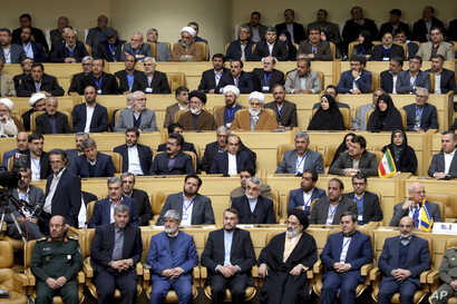 """Iranian officials listen to speech of supreme leader Ayatollah Ali Khamenei during a conference titled """"international conference in support of Palestinian Intifada"""" in Tehran, Iran, Feb. 21, 2017."""