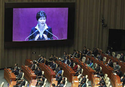 South Korean President Park Geun-hye, shown on a large screen, delivers a speech at the National Assembly in Seoul, South Korea, Oct. 24, 2016.