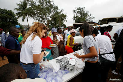 FILE - A nongovernmental organization distributes meals to victims of August mudslide at the internally displaced persons camp in Regent, Sierra Leone, Aug. 19, 2017.