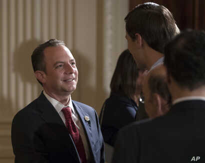 FILE - White House Chief of Staff Reince Priebus talks with White House senior adviser Jared Kushner in the East Room of the White House in Washington, July 26, 2017.