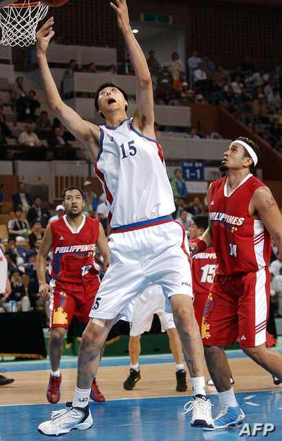 North Korean basketball player Ri Myoung-Hun competes at the 14th Asian Games in Busan, South Korea in Sept. 2002