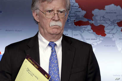 National security adviser John Bolton listens during a press briefing at the White House, Jan. 28, 2019, in Washington.