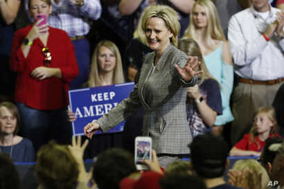 Sen. Cindy Hyde-Smith, R-Miss., walks on to the stage after being introduced by President Donald Trump at a rally on Oct. 2, 2018, in Southaven, Mississippi.